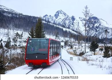 HREBIENOK, SLOVAKIA - JANUARY 07, 2015: View of the funicular railway at High Tatras mountains National park in Slovakia. Railroad leads to popular ski resort Hrebienok from Stary Smokovec village.