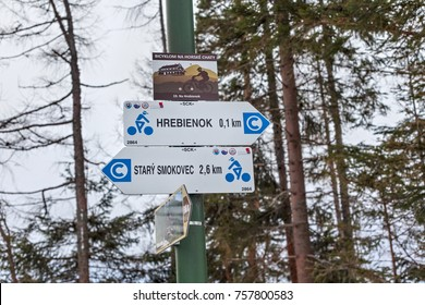 HREBIENOK, SLOVAKIA - JANUARY 07, 2015: Signs with indication of tourist destinations in the High Tatras mountains National park. It is the one of the most visited of the national parks in Slovakia.