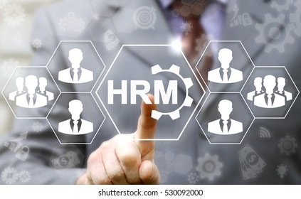 HRM business teamwork concept. Human resources management cogwheel icon. Businessman presses hrm gear button on virtual screen on background of social network people man team sign