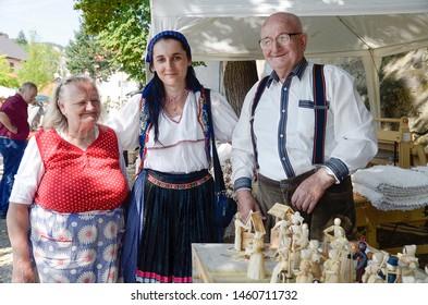 "HRUSOV, SLOVAKIA - JULY 28, 2018: ""HONTIANSKA PARADA"" Festival of Folk Art and Crafts. Fair of rustic crafts. Folk artisans with handmade corn dolls. Central Europe. Slovak republic"
