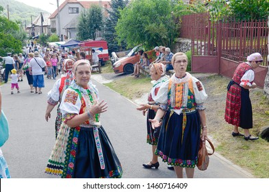 "HRUSOV, SLOVAKIA - JULY 28, 2018: ""HONTIANSKA PARADA"" Festival of Folk Art and Crafts. Fair of traditional rustic crafts. Women in traditional local garbs. Central Europe. Slovak republic"