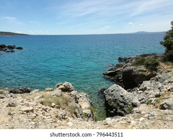 Hrvatian Porec rocky beach of Medditerean sea.
