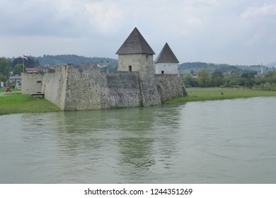 Hrvatska Kostajnica Croatia September 8th 2014 old castle wall with towers on the river