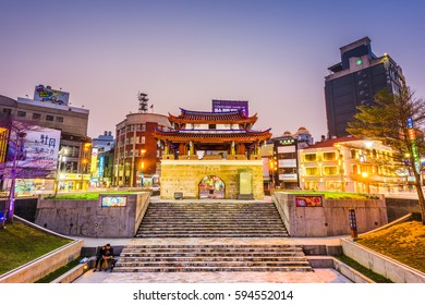 HSINCHU, TAIWAN - MARCH 5, 2017: Downtown Hsinchu cityscape with the Eastern Gate. The gate is the last remaining of Hsinchu's historic city wall.