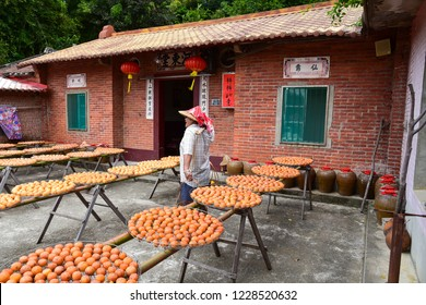 "Hsinchu, Taiwan - OCT 10, 2018: Process of Making Dried Persimmon during Windy Autumn in Hsinpu (With Chinese Name of the Factory""Wei Wei Gia"")."