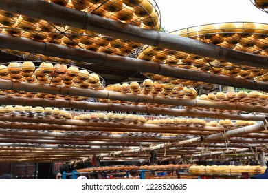 """Hsinchu, Taiwan - OCT 10, 2018: Process of Making Dried Persimmon during Windy Autumn in Hsinpu (With Chinese Name of the Factory""""Wei Wei Gia"""")."""