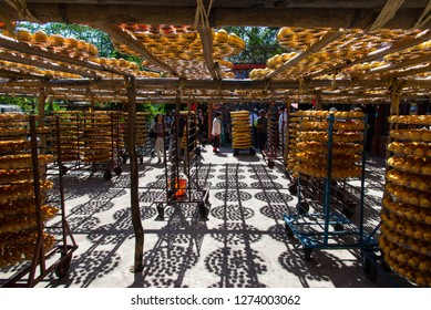 Hsinchu, Taiwan - October 14, 2015: Many tourists are playing in the persimmon merchants in Hsinchu