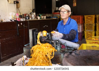 Hsinchu,Taiwan - October 28, 2018: Making dried persimmons in HsinPu.