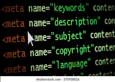 HTML web page computer programming code meta tags in red light and dark green with mouse pointer on black background seo optimization ranking search engines