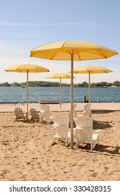 HTO is a public urban beach in Toronto. The park's standout feature is a sandpit that holds Muskoka chairs and enormous fixed yellow metal umbrellas./HTO Park Beach