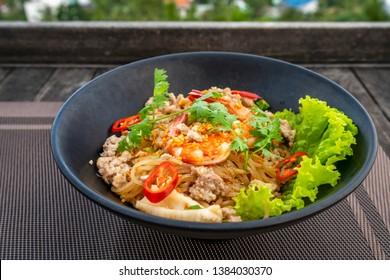 Hu Tieu Nam Vang or Hu Tiu Nam Vang Vietnamese food, Phnom-penh clear rice noodle soup, famous food originated from Cambodia at Phu Quoc island, Vietnam. High view to Duong Dong town