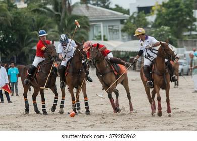 HUA HIN, THAILAND - APRIL 25: Thai Polo Team (white) plays against India Polo Team (red) during 2015 Beach Polo Asia Championship on April 25, 2015 in Hua Hin, Thailand.