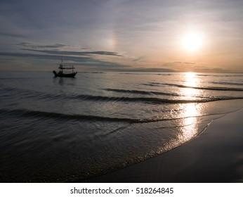 HUA HIN THAILAND : fishing boat on golden light sunrise time seascape