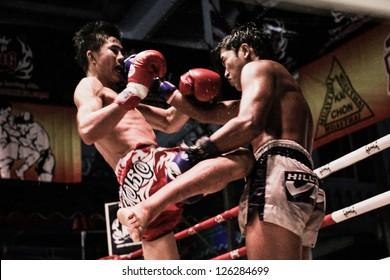 "HUA HIN THAILAND- JANUARY 25 : Unidentified players in Muaythai "" Muay Thai Kai Chon"" on January 25 , 2013 at Khoa Kittisukato temple Hua Hin Thailand"