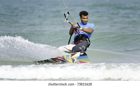 HUA HIN THAILAND - MARCH 14: PKRA Freestyle rider Alex Soto of Dominican Republic in action during Day 1 of 2011 Hua Hin Kiteboard World Cup on March 14, 2011 at Hua Hin Beach in Hua Hin, Thailand