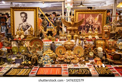 HUA HIN, THAILAND - MAY 5, 2019 : Antique clock, tea pots, small Buddha image, bowl, wood carve, chain, ring, picture and other antique for sale at Cicada night market, Hua Hin, Thailand.