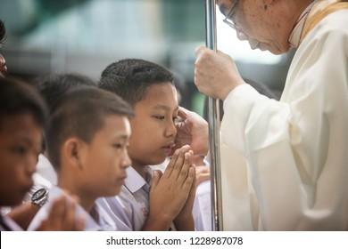 HUA HIN, THAILAND - NOVEMBER 10: Bishop Joseph Prathan Sridarunsil at inauguration ceremony of confirmants on November 10, 2018 in Hua Hin, Thailand. Confirmation is step to becamefull catholic member