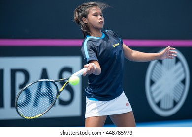 HUA HIN, THAILAND-APRIL 14:Khim Iglupas of Philippines returns a ball during Day 4 of Fed Cup by BNP Paribas on April 14, 2016 at True Arena Hua Hin in Hua Hin, Thailand