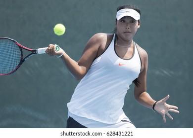 HUA HIN, THAILAND-APRIL 25:Shuyue Ma of China returns a ball during Day 2 of ITF Thailand Women's Pro Circuit on April 25, 2017 at True Arena Hua Hin in Hua Hin, Thailand