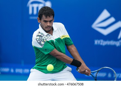 HUA HIN, THAILAND-AUGUST 22:Sidharth Rawat of India returns a ball during Day 1 of ITF Pro Circuit Thailand Men's F1 on August 22, 2016 at True Arena Hua Hin in Hua Hin, Thailand