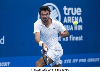 HUA HIN, THAILAND-DECEMBER 14:Fabien Reboul of France returns a ball during Day 3 of ITF Pro Circuit Thailand Men's F4 on December 14, 2016 at True Arena Hua Hin in Hua Hin, Thailand