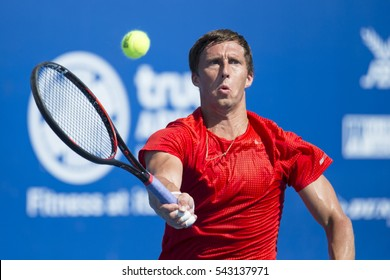 HUA HIN, THAILAND-DECEMBER 26:Ivan Nedelko of Russia returns a ball during day 1 of ITF Pro Circuit Thailand Men's F6 on December 26, 2016 at True Arena Hua Hin in Hua Hin, Thailand
