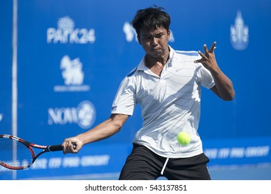HUA HIN, THAILAND-DECEMBER 26:Vorachon Rakpuanchon of Thailand returns a ball during day 1 of ITF Pro Circuit Thailand Men's F6 on December 26, 2016 at True Arena Hua Hin in Hua Hin, Thailand