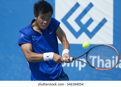 HUA HIN, THAILAND-DECEMBER 29:Fajing sun of China returns a ball during Day 4 of ITF Pro Circuit Thailand Men's F6 on December 29, 2016 at True Arena Hua Hin in Hua Hin, Thailand