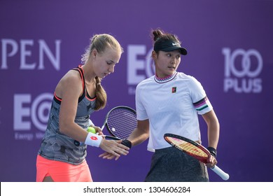 HUA HIN, THAILAND-JANUARY 30:Yafan Wang(R) of China&Anna Blinkova(L) of Russia during Doubles R1 of 2019 Toyota Thailand Open on January 30, 2019 at True Arena Hua Hin in Hua Hin, Thailand