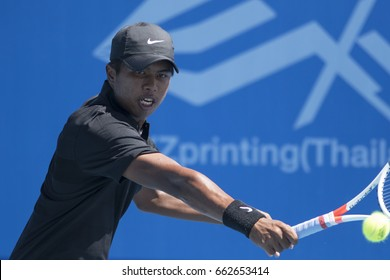 HUA HIN, THAILAND-JUNE 13:Kittirat Kerdlaphee of Thailand returns a ball during Day 2 of ITF Thailand Men's Pro Circuit on June 13, 2017 at True Arena Hua Hin in Hua Hin, Thailand