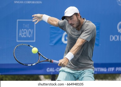 HUA HIN, THAILAND-JUNE 14:Dayne Kelly of Australia returns a ball during Day 3 of ITF Thailand Men's Pro Circuit on June 14, 2017 at True Arena Hua Hin in Hua Hin, Thailand