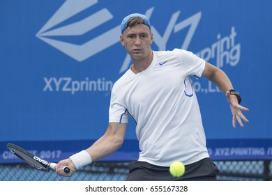 HUA HIN, THAILAND-JUNE 5:Denis Yevseyev of Kazakhstan returns a ball during Day 1 of ITF Thailand Men's Pro Circuit on June 5, 2017 at True Arena Hua Hin in Hua Hin, Thailand