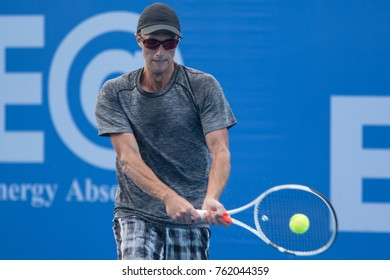 HUA HIN, THAILAND-NOVEMBER 22:Peter Polansky of Canada returns a ball during Day 3 of EA Hua Hin Open Challenger 2017 on November 22, 2017 at True Arena Hua Hin in Hua Hin, Thailand