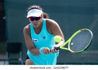 HUA HIN, THAILAND-NOVEMBER 27:Supapitch Kuearum of Thailand returns a ball during Day 2 of ITF Thailand Women's Pro Circuit on NOVEMBER 27, 2018 at True Arena Hua Hin in Hua Hin, Thailand