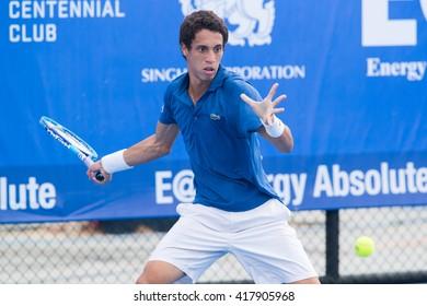 HUA HIN, THAILAND-NOVEMBER 2:Tristan Lamasine of France returns a ball during Day 1 of EA Hua Hin Open on November 2, 2015 at Hua Hin Centennial Club in Hua Hin, Thailand