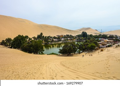 Huacachina oasis among sand dunes in Peru desert near Ica.