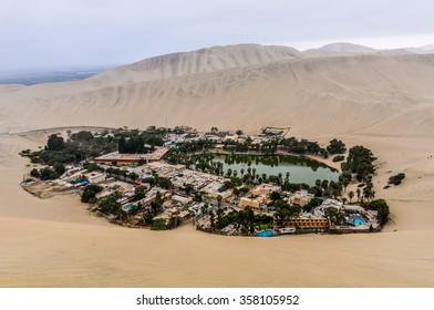 HUACACHINA, PERU - MAY 27, 2012: The oasis between the dunes of Huacachina in the coastal desert of Peru