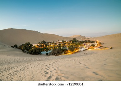 Huacachina sand dunes at sunset, a small village oasis just outside of Ica, in southern Peru