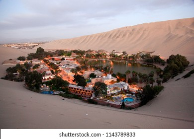 Huacachina view at dusk, an oasis in the desert of Peru that offers comfort to tourists