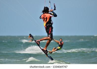 HUAHIN BEACH,PRACHUBKIRIKHAN,THAILAND March 2019:Kitesurfer during a contest of kitesurf in Huahin beach a tourist spot in Huahin, circa March 2019 in HUAHIN, THAILAND