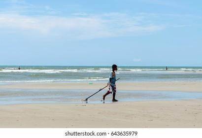 Hua-Hin, Prachuabkirikhan, Thailand - April 17, 2017: young fisherman using the clam dredges at the beach.