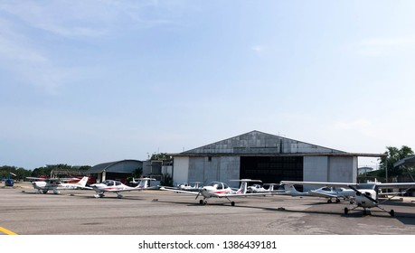 Huahin / Thailand - April 26,2019 : Aircrafts parking in front of the hangar of flight school in Huahin, Thailand