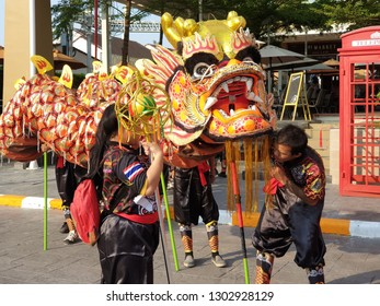 HUAHIN, THAILAND - FEBRUARY 2, 2019: Unidentified group of people perform a traditional dragon dance at Market village Huahin to celebrate traditional Chinese's lunar new year