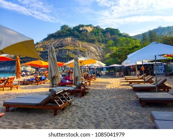 HUAHIN, THAILAND -  January 20, 2018 : Chairs and umbrellas on a beautiful tropical beach with family