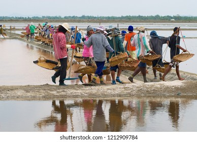 Huahin, Thailand - May 13, 2008: Unidentified people work at the salt farm in Huahin, Thailand. Salt production is one of the main industries in Huahin area.