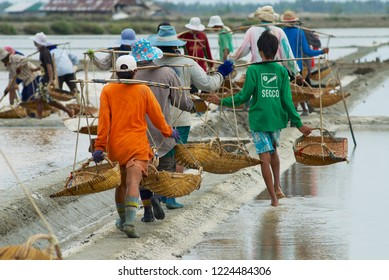 Huahin, Thailand - May 13, 2008: Unidentified people work at the salt farm in Huahin, Thailand.
