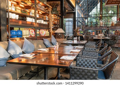 Huahin, Thailand - May 18 2019 : Restaurant modern industrial design with dining table and ancient collection at Air Space