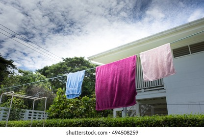 HUAHIN, THAILAND - October 1, 2016 : Hanging the towel after have fun on the beach