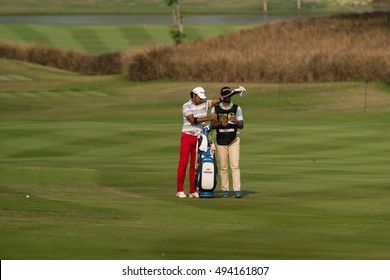 HUAHIN, THAILAND-FEBRUARY 12: Jyoti Randhawa of India and caddy during Round 1 of 2015 True Thailand Classic on February 12, 2015 at Black Mountain Golf Club in Hua Hin, Thailand