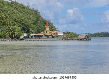 Huahine island church and fishing trap of Maeva village on the shore of the saltwater lake Fauna Nui, French Polynesia, south Pacific
